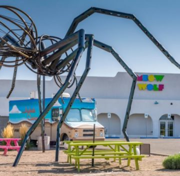 K706D2 Meow Wolf Art Complex exterior with giant spider sculpture in Santa Fe, New Mexico.